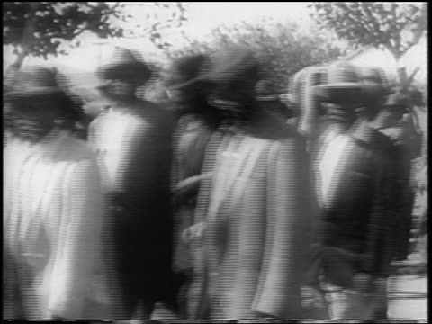 Blacks marching in protest against apartheid laws / South Africa / newsreel
