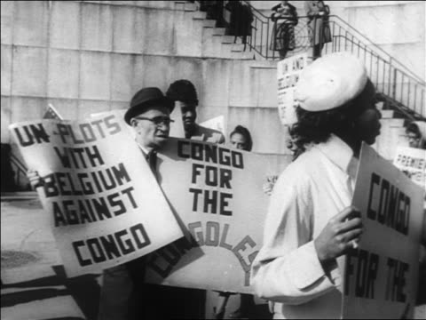 blacks marching with signs protesting un intervention in congo / nyc / newsreel - united nations stock videos & royalty-free footage