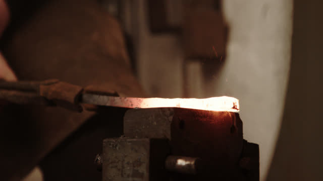 blacksmith automatic hammering the molten metal - viking stock videos and b-roll footage