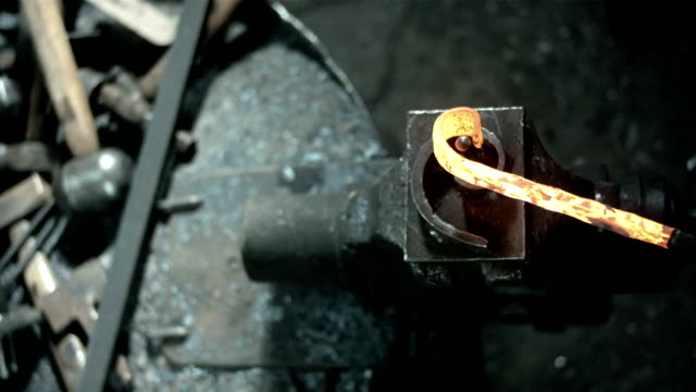 hd: blacksmith bending wrought iron - curve stock videos & royalty-free footage