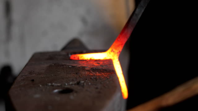 Blacksmith Designing Knife Handle on Anvil
