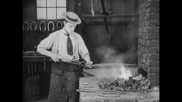 1922 blacksmith (buster keaton) fixes his own watch - checking the time stock videos & royalty-free footage