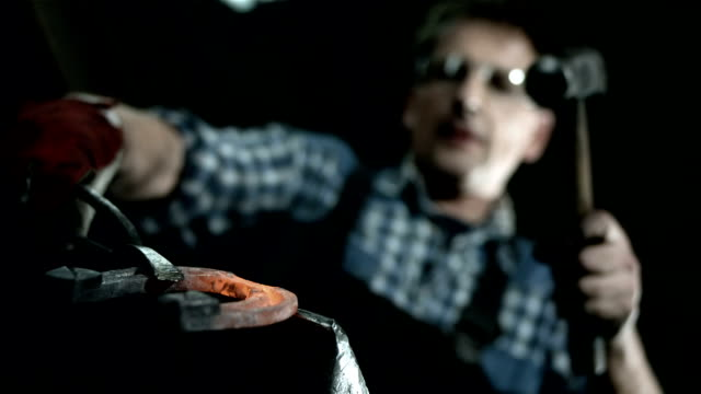 HD: Blacksmith Forging A Horseshoe