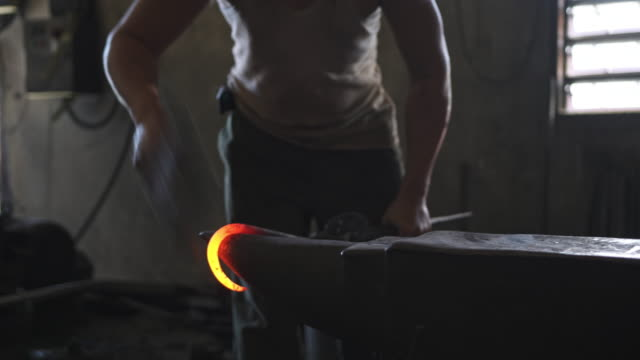 blacksmith forging hot iron on the anvil - blacksmith stock videos & royalty-free footage