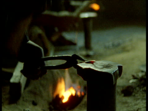 blacksmith hammers metal in smithy, djenne - strike industrial action stock videos & royalty-free footage