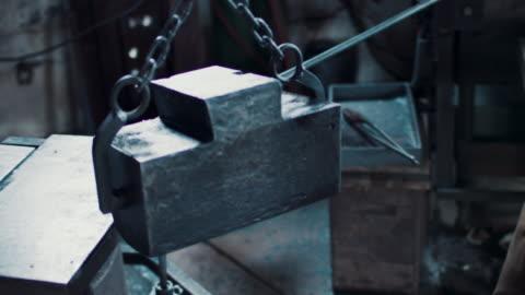 blacksmith hoisting anvil - hoisting stock videos & royalty-free footage