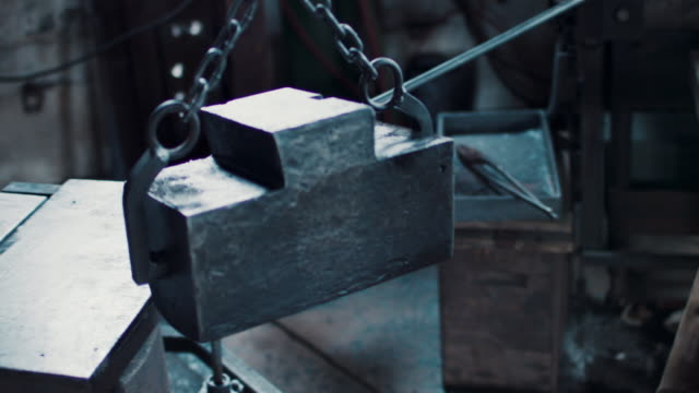 blacksmith hoisting anvil - hoisting stock videos & royalty-free footage