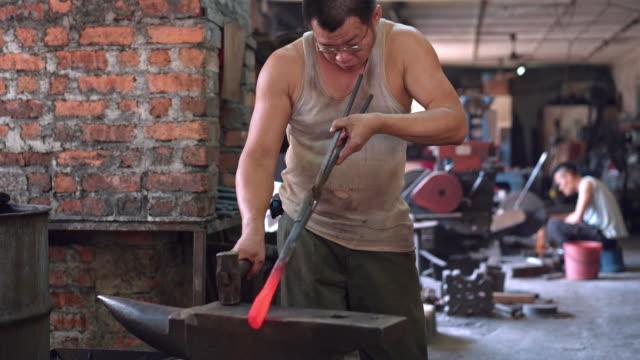 Blacksmith in a workshop