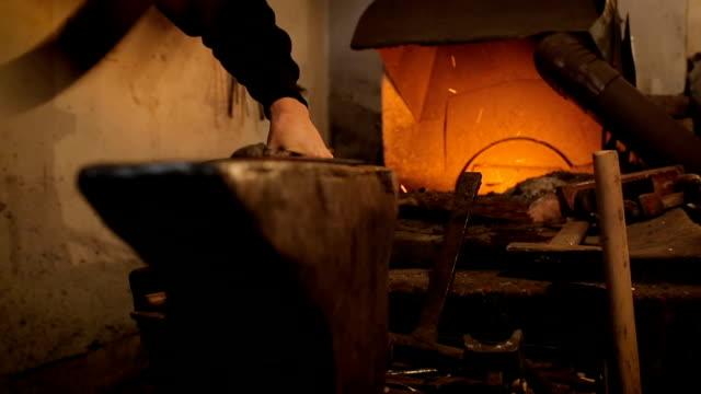 Blacksmith in blacksmith shop