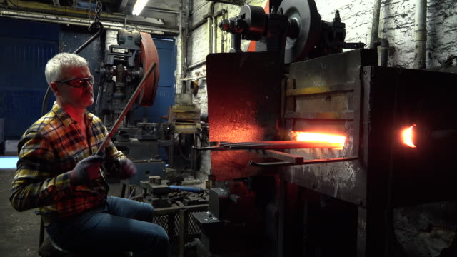blacksmith inserting metal to furnace - sheffield stock videos & royalty-free footage