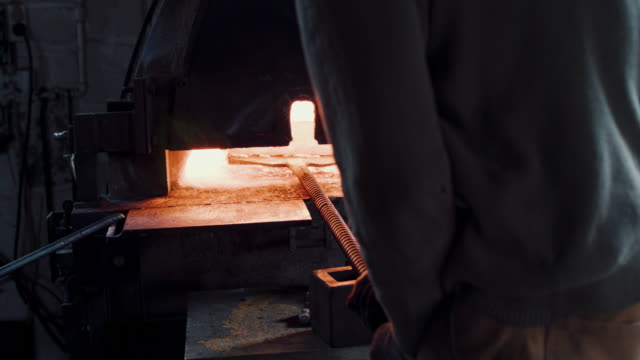 blacksmith inserting metal - metal plate stock videos & royalty-free footage