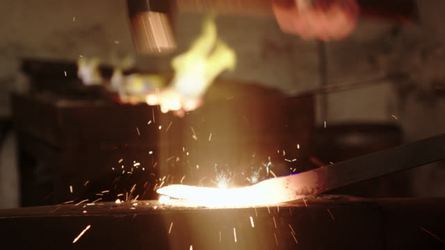 blacksmith manually forging the molten metal - blacksmith stock videos & royalty-free footage