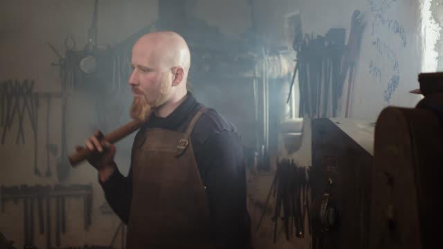 blacksmith portrait in his workshop - work tool stock videos & royalty-free footage