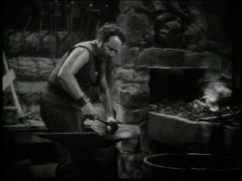 1940 ms blacksmith pounding metal into shape / united states - sledgehammer stock videos & royalty-free footage