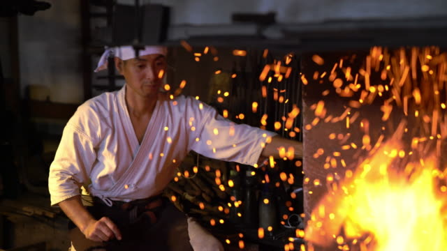 blacksmith pumping the bellows in his furnace - japanese culture stock videos & royalty-free footage