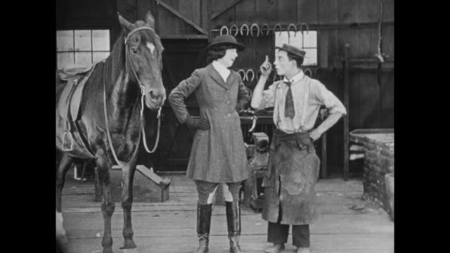 1922 Blacksmith (Buster Keaton) sells horsewoman shock-absorber saddle