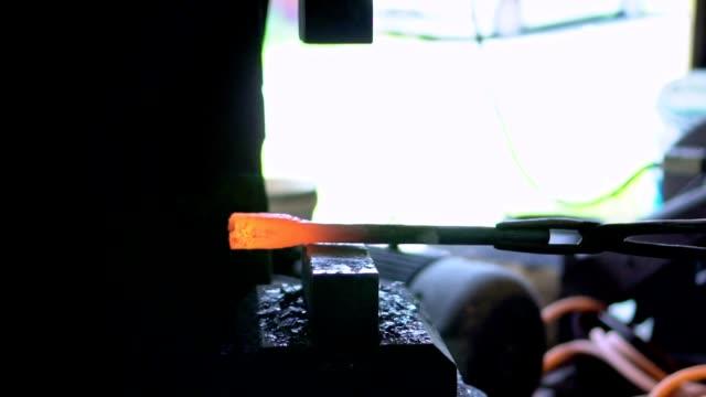 Blacksmith Shaping a Piece of Iron with Hydraulic Press Machine