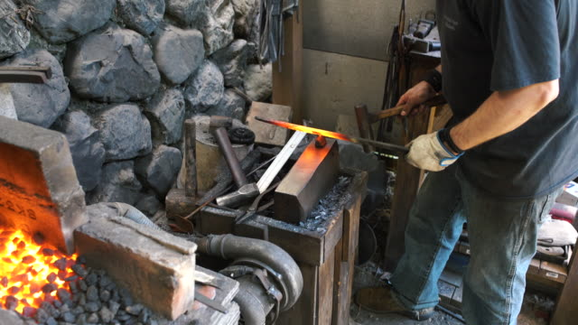 blacksmith shaping a traditional japanese cooking knife - blacksmith stock videos & royalty-free footage