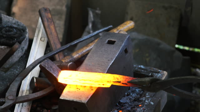 blacksmith shaping a traditional japanese cooking knife - craftsperson stock videos and b-roll footage