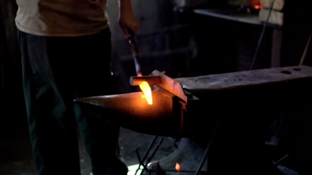 blacksmith shaping an iron with hammer - bending stock videos & royalty-free footage