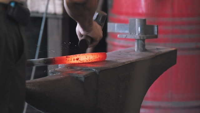 blacksmith shaping metal on anvil - hammer stock videos & royalty-free footage