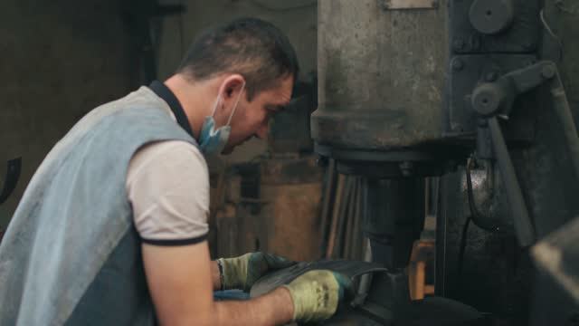 blacksmith shop in the old city of kashgar,kashgar, xinjiang, china - craft点の映像素材/bロール