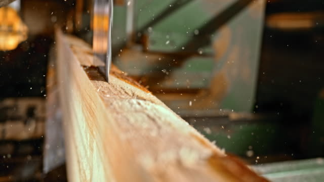 slo mo blade of a vertical saw cutting a log into planks - lumberyard stock videos and b-roll footage