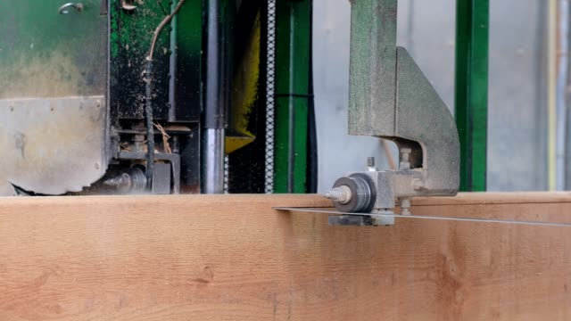 blade sawing through the large pieces of wood - timber yard stock videos & royalty-free footage