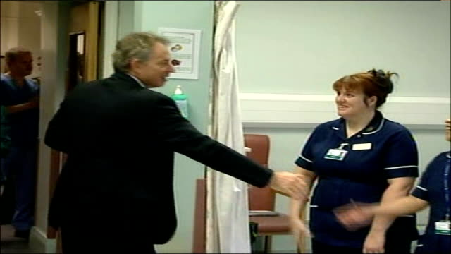 east london bethnal green int tony blair mp and patricia hewitt mp arrive at hospital and shake hands with staff blair and hewitt sitting with group... - bethnal green stock videos & royalty-free footage