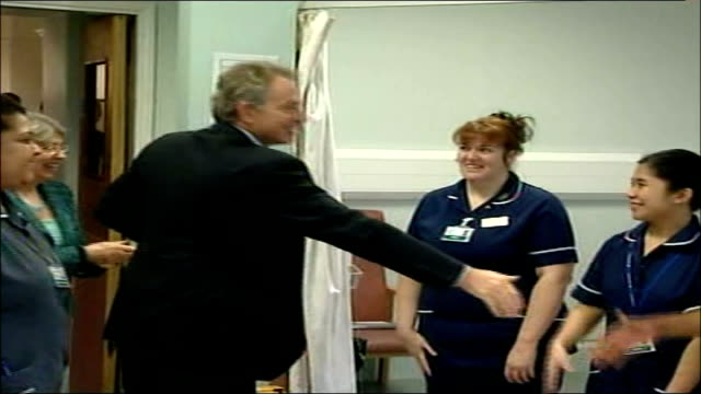 east london bethnal green london chest hospital int tony blair mp and patricia hewitt mp arriving for visit and shake hands with staff work room seen... - bethnal green stock videos & royalty-free footage