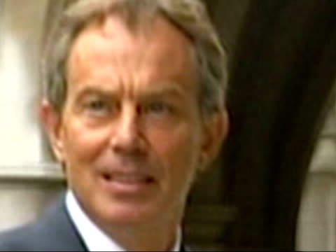 blair bbc to receive report day before publication lib slow motion prime minister tony blair mp along downing street car pulling up as blair out... - publication stock videos & royalty-free footage