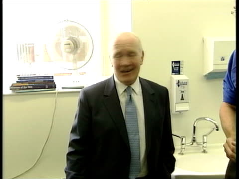 Blair completes reshuffle/Lord Chancellor issues ITN Dr John Reid MP shaking hands with people during a visit to a hospital PAN CMS Dr John Reid MP...