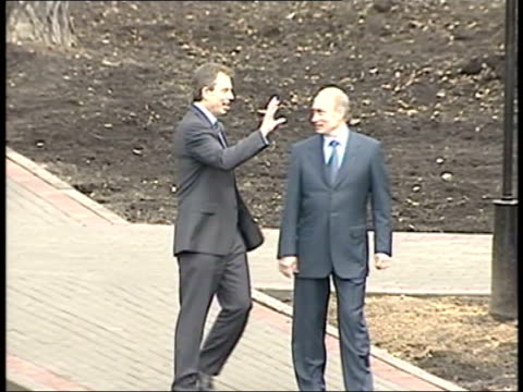 blair meeting with putin pool russian federation moscow ext cms president vladimir putin shaking hands with and embracing british prime minister tony... - weapons of mass destruction stock videos and b-roll footage
