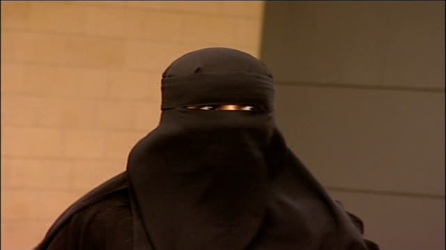 Blair speech on multiculturalism and integration FILE / TX Leeds EXT Aishah Azmi poses for photocall wearing niqab face veil Azmi into press...