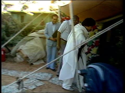 background lib colonel gaddafi and trevor mcdonald into tent - muammar gaddafi stock videos & royalty-free footage