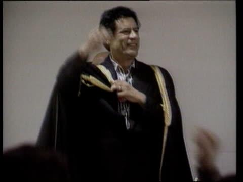 background lib colonel gaddafi wearing black robe and waving - muammar gaddafi stock videos & royalty-free footage