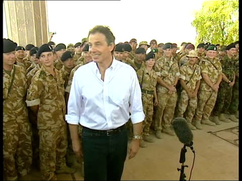 blair visit to basra; itn iraq basra ext prime minister tony blair mp shaking hands with group of muslim girls on walkabout during visit to iraq... - basra stock-videos und b-roll-filmmaterial