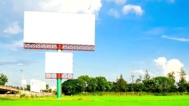 stockvideo's en b-roll-footage met blank advertising billborad on paddy field - plakkaat