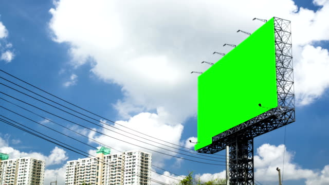 blank billboard with time lapse clouds - billboard stock videos & royalty-free footage