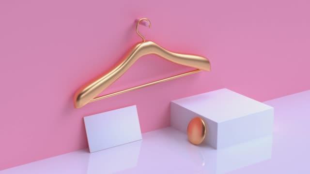 vídeos y material grabado en eventos de stock de tarjeta de visita en blanco geométrico de la forma metálica colgante de oro de la ropa rosa pared pastel escena 3d - naturaleza muerta