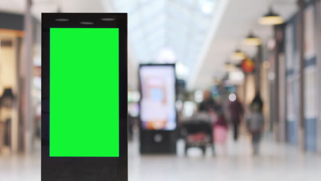 vídeos de stock e filmes b-roll de blank electronic billboard in a shopping area - billboard