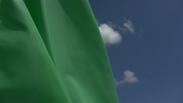 HD 720 Blank Green Flag with blue sky background