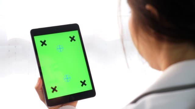 blank green screen digital tablet - coffee shop background stock videos & royalty-free footage