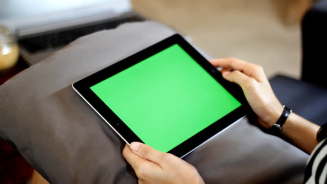 blank green screen tablet one click close up with hand