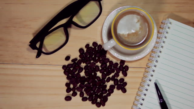 Blank notebook and coffee on the table.