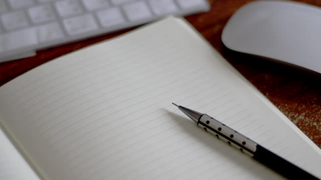 blank notebook with pencil on working table - note pad stock videos & royalty-free footage