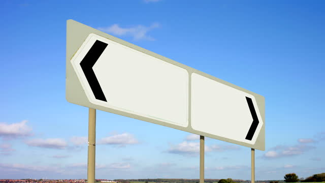 blank signpost. lack of direction. - wegweiser stock-videos und b-roll-filmmaterial