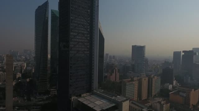 blanket of smog envelops mexico city after authorities in the sprawling urban area of over 20 million people declared an environmental alert - smog stock videos & royalty-free footage