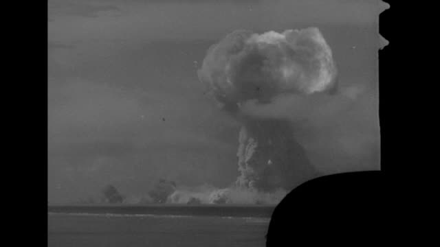 flash wilson cloud quickly dissipates mushroom cloud grows and rises - atomic bomb testing stock videos & royalty-free footage