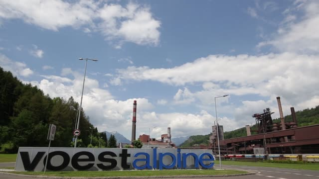 blast furnaces at the voestalpine stahl donawitz gmbh plant stand in the valley as a mountain range stand beyond in donawitz austria on tuesday may... - traditionally austrian stock videos & royalty-free footage